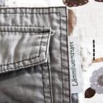 namensbaender-Gewebte Textiletiketten als Schlaufe zwischen zwei Stoffe einnaehen