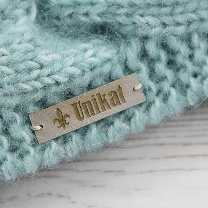 Snappap Etikett aus veganem Leder aufnähen